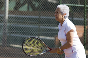 Senior lady playing tennis